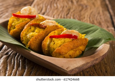Acaraje - Traditional Brazilian fritters made with black-eyed peas filled with vatapa, caruru, tomato salad and sauteed shrimp. Typical food from Bahia.