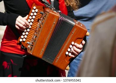 Acccordion playing pizzica music in the village piazza,Squalzino, Puglia, Italy