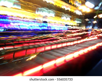 acceleration speed motion on night road in city with car light trails