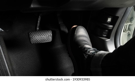 Accelerator and breaking pedal in a car. Close up the foot pressing foot pedal of a car to drive ahead. Driver driving the car by pushing accelerator pedals of the car. inside vehicle.