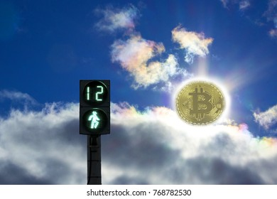 To accept bitcoin. Allow bitcoin. Green traffic light with timer on the background of sky with clouds and coins of bitcoin is the sun.