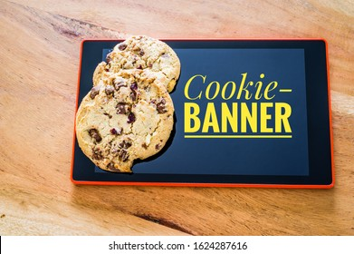 Accept cookies with a tablet to illustrate cookie banners for websites with cookies and inscription Cookie-Banner