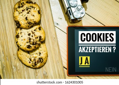Accept cookies with a tablet to illustrate cookie banners for websites with cookies in German Cookies akzeptieren JA NEIN in English Cookies accept YES NO