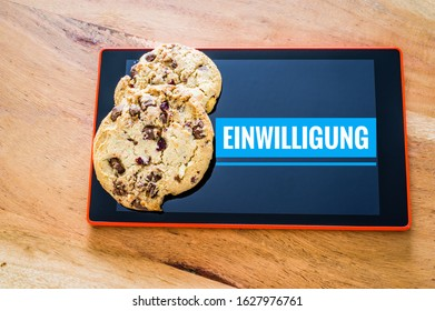 Accept cookies with a tablet to illustrate cookie banners for websites with cookies in German Einwilligung in English Consent