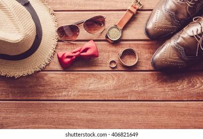 acceseries for men on the wooden floor
