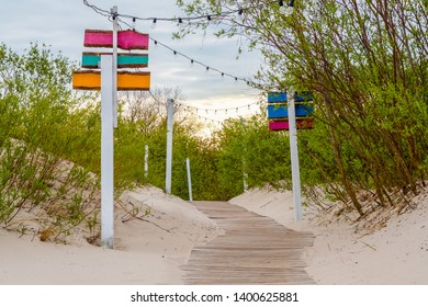Access to the Baltic Sea. Wooden walkway. Evening walkway lighting. Early morning. Weather forecast.