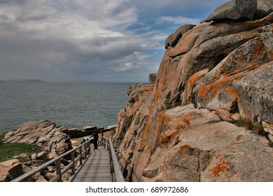 Access to the cliffs of Ccap Prioriño, Ferrol, A Coruña, Galicia, Spain,composition of wooden stairs in a surreal  landscape by the ocean, psychological photography, abstract surrealism,