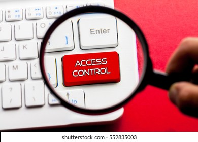 ACCESS CONTROL word written on keyboard view with magnifier glass