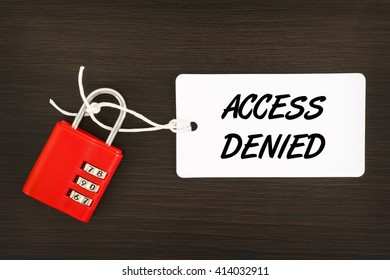 Access Denied written on label tag with combination number padlock on wooden background