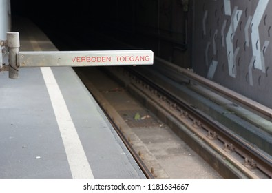 Access Forbidden sign in Dutch (Verboden Toegang), preventing people from walking on railroad tracks