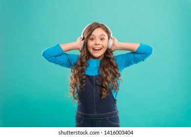 Access to knowledge. Listening lesson. Online education. Girl adorable child listening online course. Get more information. Audio book. Modern education concept. Benefits of online education.
