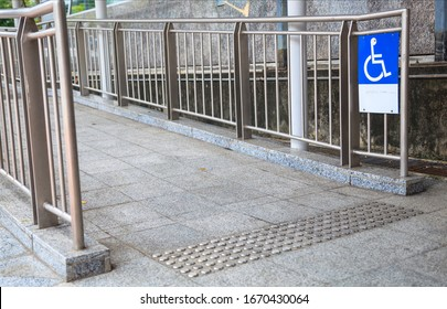 Access Ramp Sign for wheelchair ramp, an inclined plane installed in addition to or instead of stairs, for wheelchair users, people pushing strollers, carts, or wheeled objects to access buildings.