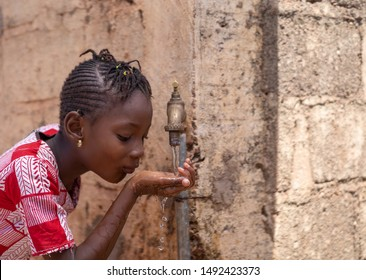Access to Water is a Human Right, cute African drinking freshwater