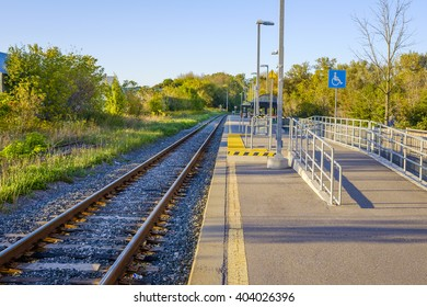An accessibility ramp at an empty commuter train station in Stouffville Ontario.