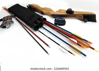 Accessories for archery. Multi-colored arrows, black quiver, fingerstall, gaiter, wooden handle and recurve bow on a white background