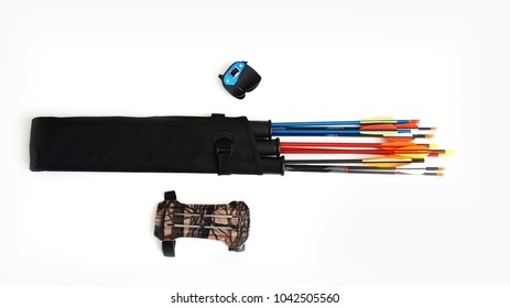 Accessories for archery. Multi-colored arrows with silvery tips in a black quiver, a fingerstall, a gaiter on a white background