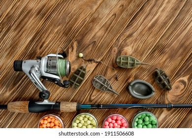 Accessories for carp fishing and fishing baits on wooden planks with copy space.