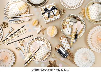 Accessories for children's parties in Gold  color. Flat lay, top view