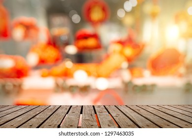Accessories Chinese new year festival,leaf,wood basket,red packet,plum blossom on table wooden background with copy space.