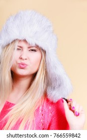 Accessories and clothes for cold days, fashion concept. Happy blonde woman in winter warm furry hat in russian style