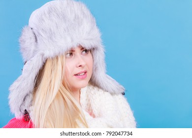 Accessories and clothes for cold days, fashion concept. Blonde woman in winter warm furry hat in russian style