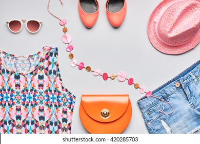 Accessories clothes fashion set. Stylish woman summer accessories, handbag clutch, pink top, denim, glamor orange shoes, trendy necklace, hat sunglasses. Summertime fashionable outfit