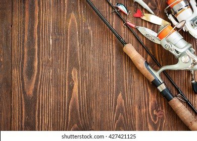 Accessories for fishing on the wooden background, with copyspace