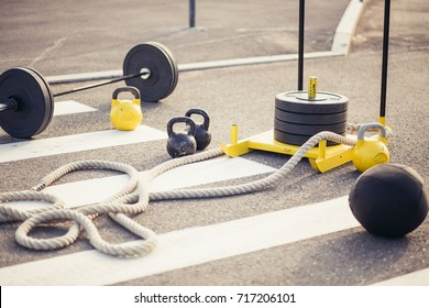 accessories for fitness. Dumbbells, weight plates, gloves rope sled