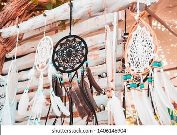 accessories and handmade dream catcher souvenirs at the hippie de las Dalias market on the island of Ibiza, in summer.