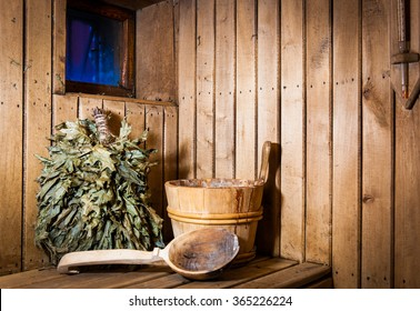 Accessories and interior of Finnish sauna. Wooden bucket with ladle