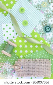 Accessories for needlework: fabric, tape, buttons, coil of threads and tag from canvas