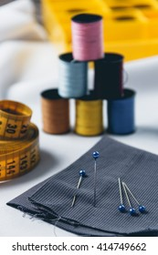 Accessories for needlework on white cloth background