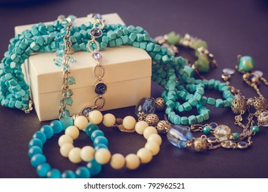 Accessories  on black background, gift box, bijouterie, bracelets, necklace