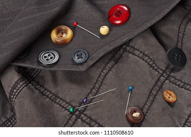 Accessories for repairing clothes on the background of cotton clothes