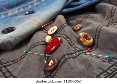 Accessories for repairing clothes on the background of cotton and jeans clothes
