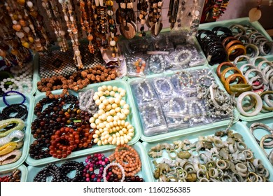 Accessories (ring, bracelet, necklace) made from stone, ivory and wood bead sell in the market in the myanmar