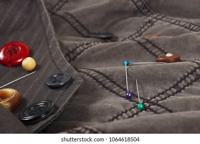 Accessories for sewing on the background of cotton clothes close up