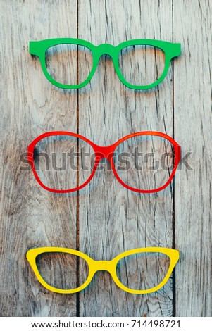e3f57a75a3 Accessories for summer recreation. Colored glasses frames placed on a  display for sale
