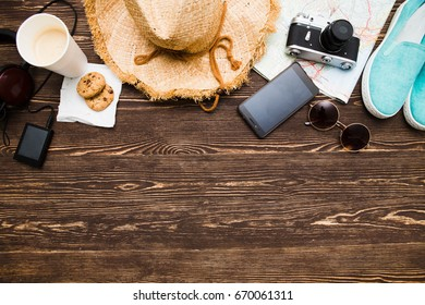 Accessories for travel top view on wooden background. Summer and Travel concept