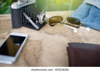 Accessories for travel,wallet,photo camera, smart phone,sunglass,smalltalk and travel map