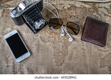 Accessories for travel,wallet,photo camera, smart phone,sunglass,smalltalk and travel map High Dynamic Range tone.