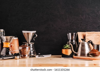 Accessories and utensils for making coffee drinks on a wooden table, coffee shop interior
