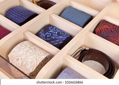 accessories in wardrobe men: neckties, belts close-up