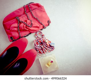 Accessories for woman, top view. Shoes, bag, perfume and necklace