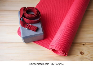 Accessories for yoga,pilates or fitness.Mat, foam block and strap.