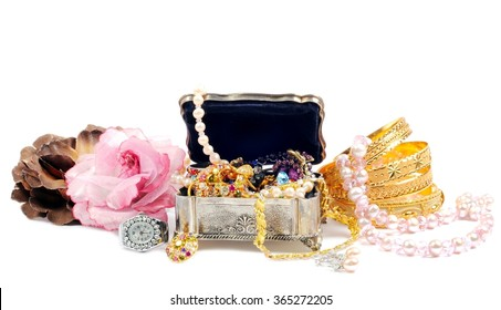 Accessory and gold jewelry in silver jewel chest, over white