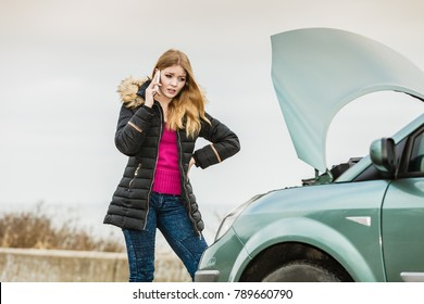 Accident and breakdowns with auto concept. Broken down car, blonde woman having problem, calling to somebody for help.