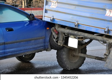 Accident, car collided with a tractor. horizontal photo.
