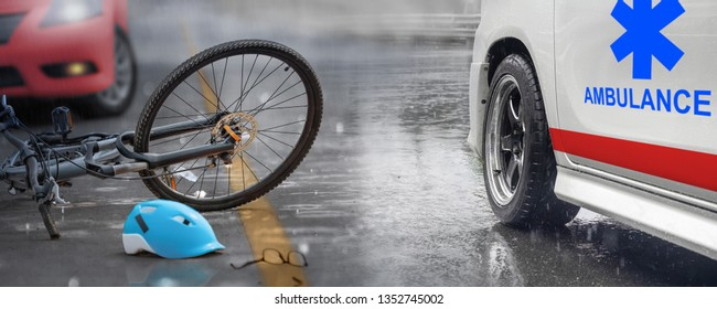 Accident car crash with bicycle on road ,rainy day.