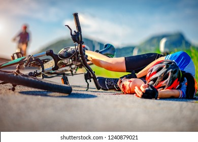 accident clashed on young woman bicyclist in hurt and injured at knee of leg and arms, after accident clashed, with mortal wound and bleeding of blood flow on the surface of street road